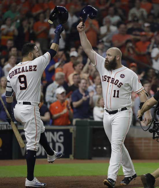 <div class='meta'><div class='origin-logo' data-origin='AP'></div><span class='caption-text' data-credit='AP'>Houston Astros' Evan Gattis is congratulated by Marwin Gonzalez after hitting a home run during the fourth inning of Game 7. (AP Photo/David J. Phillip)</span></div>