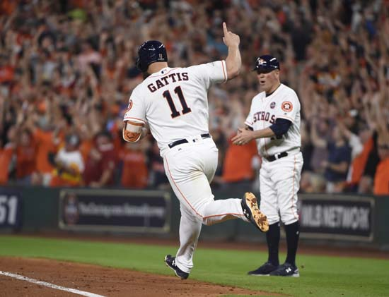 <div class='meta'><div class='origin-logo' data-origin='AP'></div><span class='caption-text' data-credit='AP'>Houston Astros' Evan Gattis celebrates after hitting a home run during the fourth inning of Game 7. (AP Photo/Eric Christian Smith)</span></div>