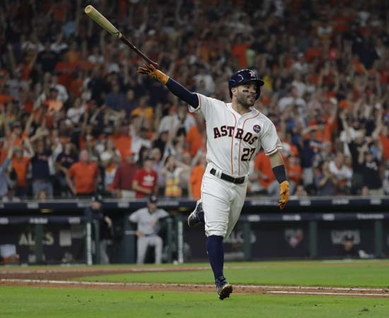 <div class='meta'><div class='origin-logo' data-origin='AP'></div><span class='caption-text' data-credit='AP'>Houston Astros' Jose Altuve celebrates after hitting a home run during the fifth inning of Game 7. (AP Photo/David J. Phillip)</span></div>