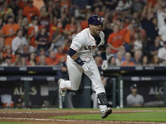 <div class='meta'><div class='origin-logo' data-origin='AP'></div><span class='caption-text' data-credit='AP'>Houston Astros' Yuli Gurriel reacts after hitting a single during the fifth inning of Game 7. (AP Photo/David J. Phillip)</span></div>