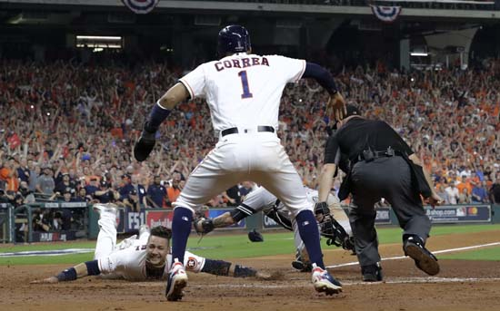 <div class='meta'><div class='origin-logo' data-origin='AP'></div><span class='caption-text' data-credit='AP'>Houston Astros' Yuli Gurriel reacts as he scores during the fifth inning of Game 7. (AP Photo/David J. Phillip)</span></div>