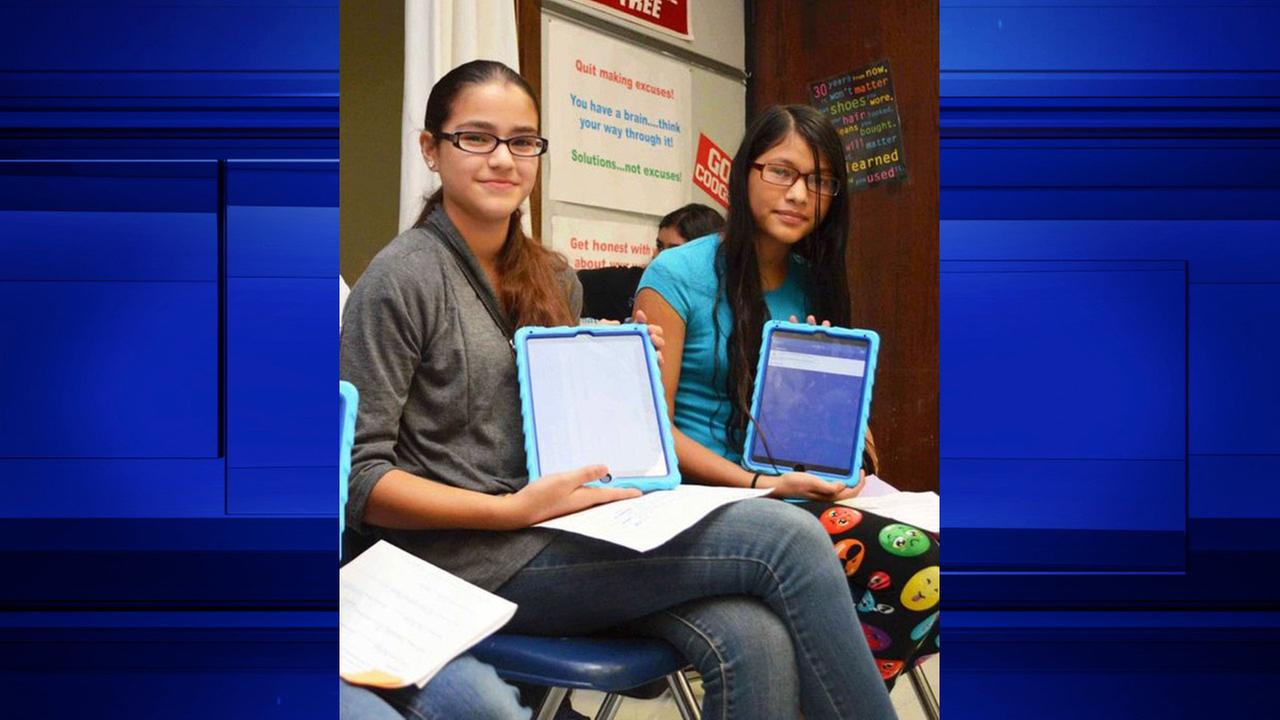 Deepwater Jr. High seventh-graders Nelly Alvarado and Daniela Reyes proudly show-off their new iPads they will use this school year through Deer Park ISDs new initiative.