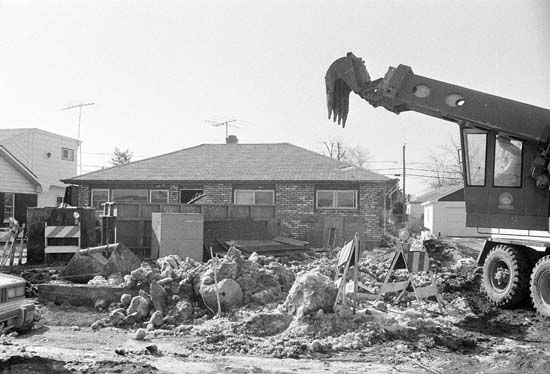 <div class='meta'><div class='origin-logo' data-origin='none'></div><span class='caption-text' data-credit='Photo/CEK'>The demolition of the home of serial killer John Wayne Gacy, Jr. on April 11, 1979.</span></div>