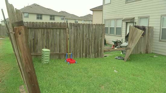 <div class='meta'><div class='origin-logo' data-origin='none'></div><span class='caption-text' data-credit='KTRK Photo'>Damage to a fence following severe storms in the Houston area</span></div>