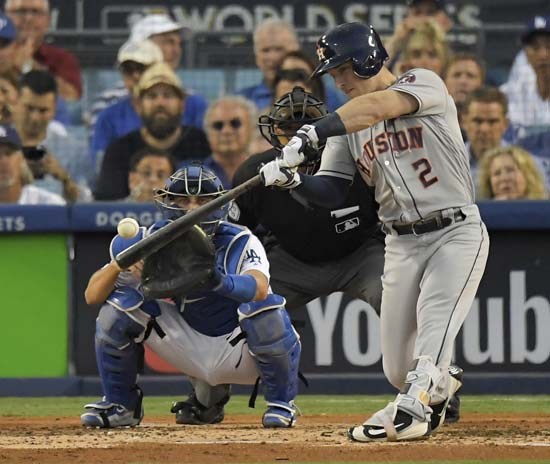 <div class='meta'><div class='origin-logo' data-origin='AP'></div><span class='caption-text' data-credit='AP'>Houston Astros' Alex Bregman hits an RBI single during the third inning of Game 2 of baseball's World Series against the Los Angeles Dodgers. (AP Photo/Mark J. Terrill)</span></div>