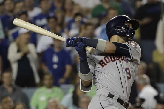 <div class='meta'><div class='origin-logo' data-origin='AP'></div><span class='caption-text' data-credit='AP'>Houston Astros' Marwin Gonzalez hits a home run during the ninth inning of Game 2 of baseball's World Series against the Los Angeles Dodgers. (AP Photo/David J. Phillip)</span></div>