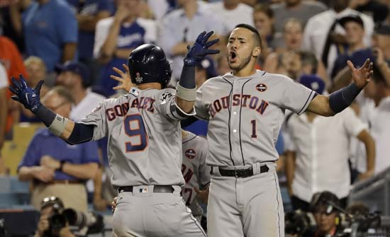 <div class='meta'><div class='origin-logo' data-origin='AP'></div><span class='caption-text' data-credit='AP'>Houston Astros' Marwin Gonzalez celebrates his home run with Carlos Correa during the ninth inning of Game 2 . (AP Photo/Matt Slocum)</span></div>
