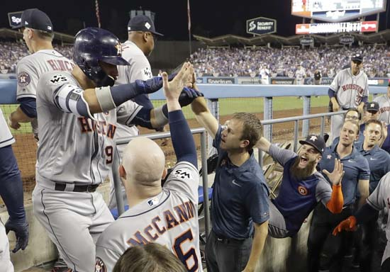 <div class='meta'><div class='origin-logo' data-origin='AP'></div><span class='caption-text' data-credit='AP'>Houston Astros' Marwin Gonzalez is congratulated after hitting a home run during the ninth inning of Game 2. (AP Photo/David J. Phillip)</span></div>