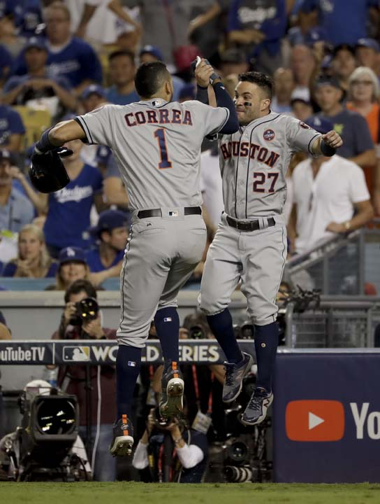 <div class='meta'><div class='origin-logo' data-origin='AP'></div><span class='caption-text' data-credit='AP'>Houston Astros' Carlos Correa, left, and Jose Altuve celebrates their back-to-back home run against the Los Angeles Dodgers during the 10th inning of Game 2. (AP Photo/Matt Slocum)</span></div>