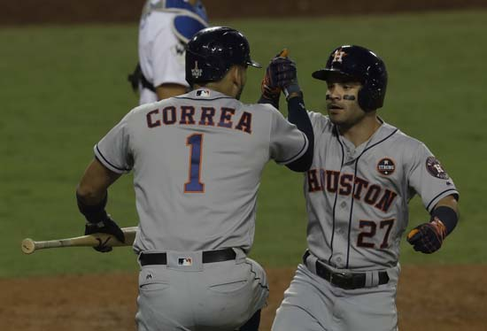 <div class='meta'><div class='origin-logo' data-origin='AP'></div><span class='caption-text' data-credit='AP'>Houston Astros' Jose Altuve is congratulated by Carlos Correa after hitting a home run during the 10th inning of Game 2. (AP Photo/Alex Gallardo)</span></div>