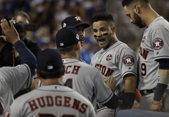 <div class='meta'><div class='origin-logo' data-origin='AP'></div><span class='caption-text' data-credit='AP'>Houston Astros' Jose Altuve is congratulated after hitting a home run during the 10th inning of Game 2. (AP Photo/David J. Phillip)</span></div>