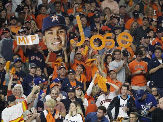 <div class='meta'><div class='origin-logo' data-origin='AP'></div><span class='caption-text' data-credit='AP'>Fans cheer during the first inning of Game 3 of baseball's World Series between the Houston Astros and the Los Angeles Dodgers. (AP Photo/David J. Phillip)</span></div>