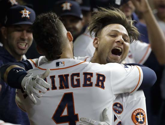 <div class='meta'><div class='origin-logo' data-origin='AP'></div><span class='caption-text' data-credit='AP'>Astros' Yuli Gurriel is congratulated by George Springer after hitting a home run during the second inning of Game 3. (AP Photo/David J. Phillip)</span></div>