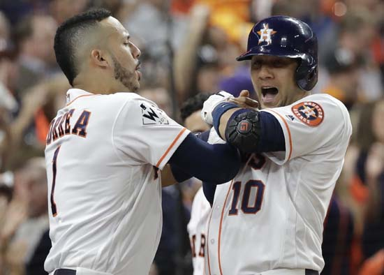 <div class='meta'><div class='origin-logo' data-origin='AP'></div><span class='caption-text' data-credit='AP'>Houston Astros' Yuli Gurriel is congratulated by Carlos Correa after hitting a home run during the first inning of Game 3. (AP Photo/David J. Phillip)</span></div>