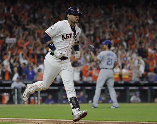 <div class='meta'><div class='origin-logo' data-origin='AP'></div><span class='caption-text' data-credit='AP'>Houston Astros' Yuli Gurriel reacts after hitting a home run during the first inning of Game 3. (AP Photo/David J. Phillip)</span></div>