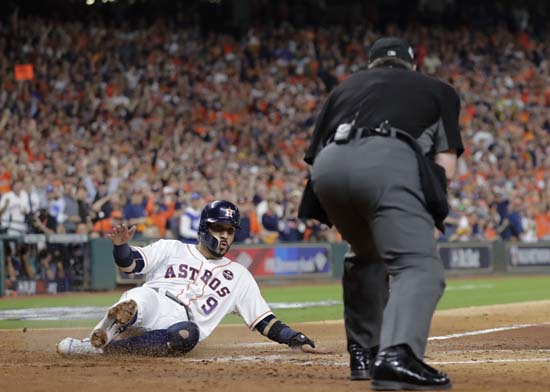 <div class='meta'><div class='origin-logo' data-origin='AP'></div><span class='caption-text' data-credit='AP'>Houston Astros' Marwin Gonzalez scores on a sacrifice fly by Alex Bregman during the second inning of Game 3. (AP Photo/David J. Phillip)</span></div>
