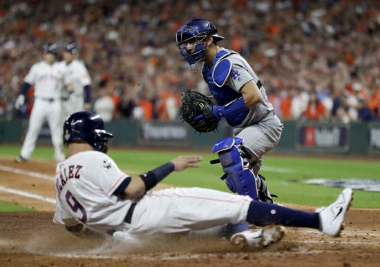 <div class='meta'><div class='origin-logo' data-origin='AP'></div><span class='caption-text' data-credit='AP'>Houston Astros' Marwin Gonzalez scores past Los Angeles Dodgers catcher Austin Barnes on a sacrifice fly during the second inning of Game 3. (AP Photo/Matt Slocum)</span></div>