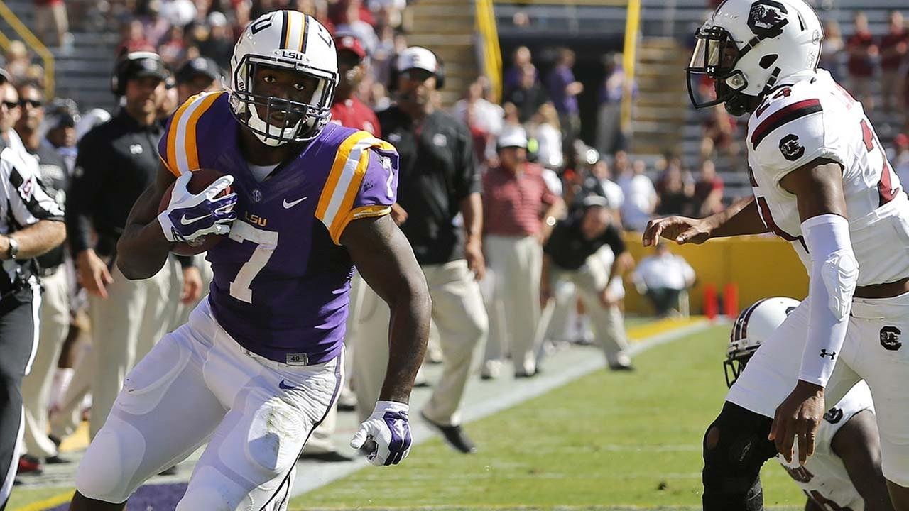 LSU running back Leonard Fournette (7) runs against South Carolina safety D.J. Smith (24) during the first half of an NCAA college football game in Baton Rouge, La.