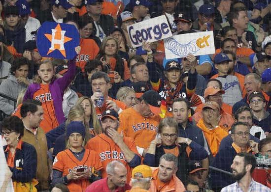 <div class='meta'><div class='origin-logo' data-origin='AP'></div><span class='caption-text' data-credit='AP'>Fans cheer during the first inning of Game 4 of baseball's World Series between the Houston Astros and the Los Angeles Dodgers. (AP Photo/David J. Phillip)</span></div>