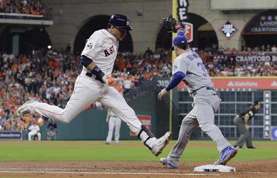 <div class='meta'><div class='origin-logo' data-origin='AP'></div><span class='caption-text' data-credit='AP'>Houston Astros' Yuli Gurriel is out at first as Los Angeles Dodgers' Cody Bellinger takes the throw to turn a double play during the second inning. (AP Photo/David J. Phillip)</span></div>