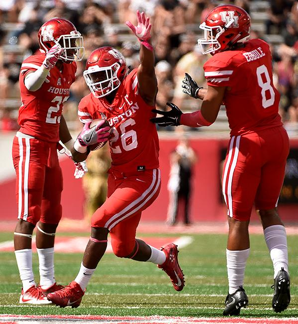 "<div class=""meta image-caption""><div class=""origin-logo origin-image ap""><span>AP</span></div><span class=""caption-text"">Houston cornerback Brandon Wilson, center, celebrates his interception of a Central Florida pass with Terrell Williams, left, and Emeke Egbule (8). (AP Photo/Eric Christian Smith)</span></div>"