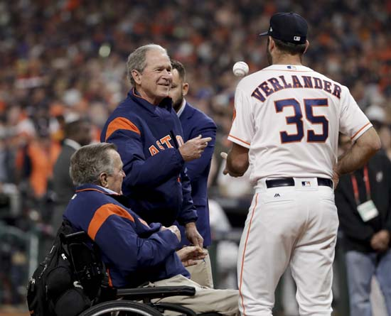 <div class='meta'><div class='origin-logo' data-origin='AP'></div><span class='caption-text' data-credit='AP'>Houston Astros' Justin Verlander greets Former President George H.W. Bush after George W. Bush threw the ceremonial first pitch before Game 5. (AP Photo/Matt Slocum)</span></div>