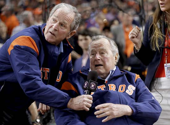 <div class='meta'><div class='origin-logo' data-origin='AP'></div><span class='caption-text' data-credit='AP'>Former Presidents George H.W. Bush and George W. Bush make the play ball announcement before Game 5 of baseball's World Series. (AP Photo/David J. Phillip)</span></div>