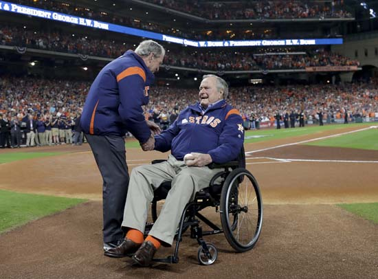 <div class='meta'><div class='origin-logo' data-origin='AP'></div><span class='caption-text' data-credit='AP'>Former Presidents George H.W. Bush and George W. Bush shake hands before the first pitch ceremony at Game 5. (AP Photo/David J. Phillip)</span></div>