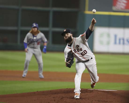 <div class='meta'><div class='origin-logo' data-origin='AP'></div><span class='caption-text' data-credit='AP'>Houston Astros starting pitcher Dallas Keuchel throws during the first inning of Game 5. (AP Photo/Thomas B. Shea, Pool)</span></div>