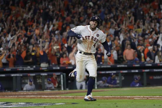 <div class='meta'><div class='origin-logo' data-origin='AP'></div><span class='caption-text' data-credit='AP'>Houston Astros' George Springer celebrates his home run during the seventh inning of Game 5. (AP Photo/David J. Phillip)</span></div>