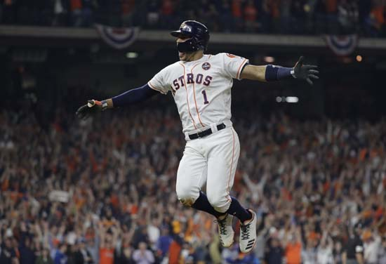 <div class='meta'><div class='origin-logo' data-origin='AP'></div><span class='caption-text' data-credit='AP'>Houston Astros' Carlos Correa celebrates his two-run home run during the seventh inning of Game 5. (AP Photo/David J. Phillip)</span></div>