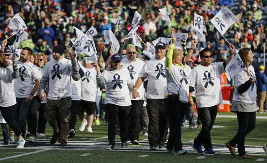 <div class='meta'><div class='origin-logo' data-origin='AP'></div><span class='caption-text' data-credit='AP'>Cancer survivors and supporters take the field during halftime of an NFL football game between the Seattle Seahawks and the Houston Texans. (AP Photo/Stephen Brashear)</span></div>