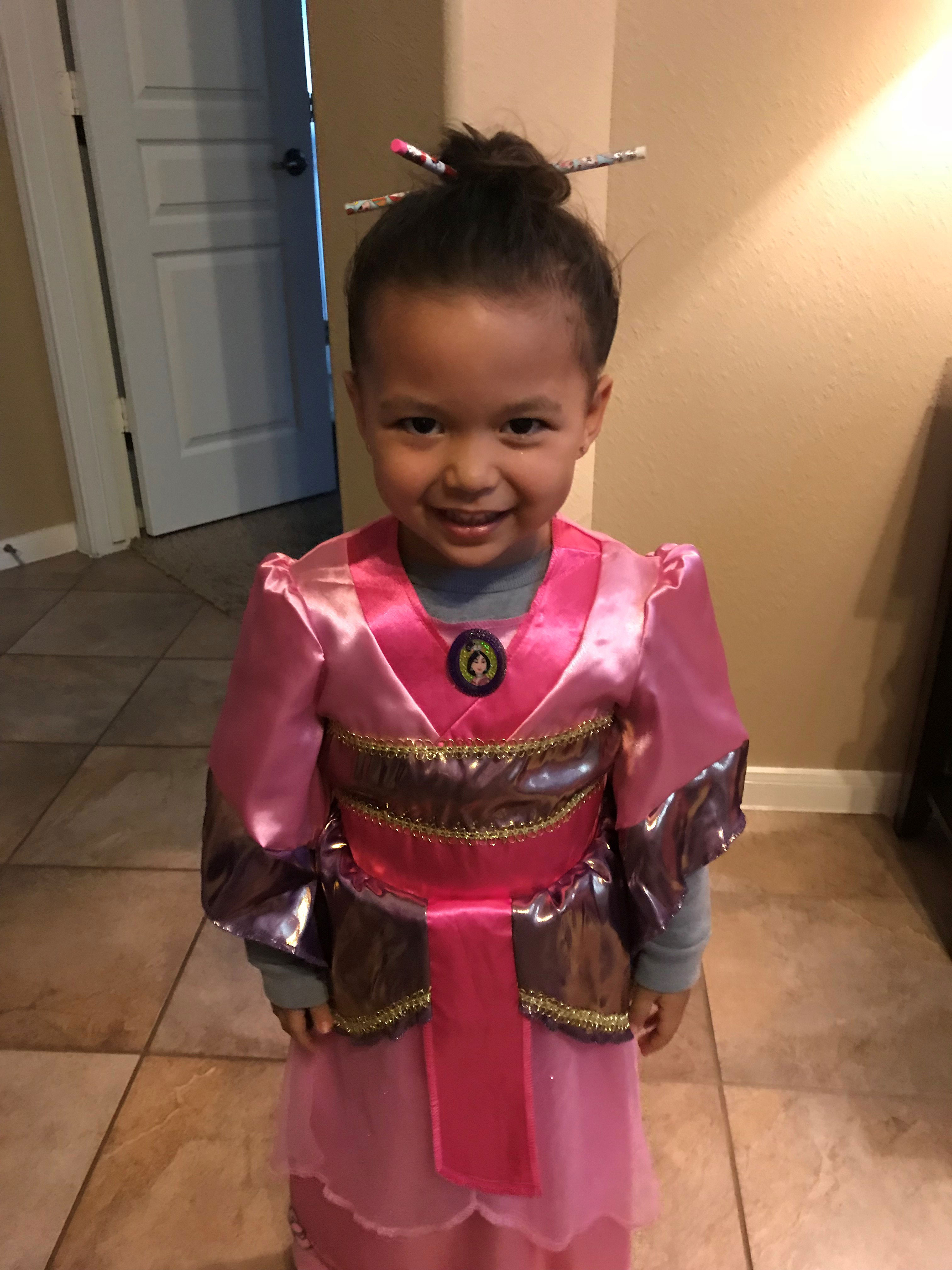 "<div class=""meta image-caption""><div class=""origin-logo origin-image none""><span>none</span></div><span class=""caption-text"">ABC13 meteorologist Elita Loresca's daughter shows off her gorgeous pink kimono as she portrays Disney's Mulan.</span></div>"