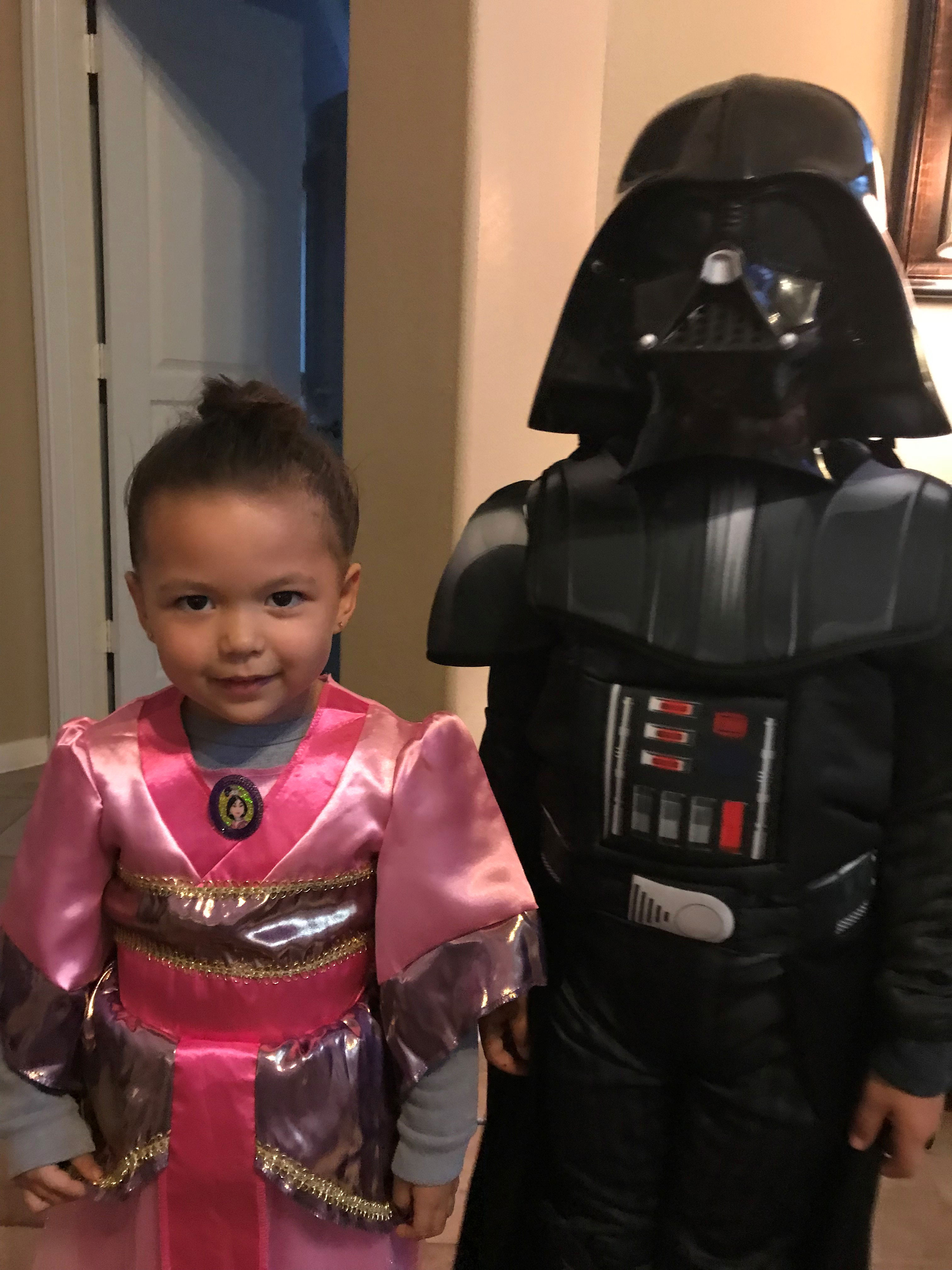 "<div class=""meta image-caption""><div class=""origin-logo origin-image none""><span>none</span></div><span class=""caption-text"">The force is strong with Elita Loresca's children this Halloween, as her daughter portrays Disney's Mulan and her son dresses as Star Wars' Darth Vader.</span></div>"
