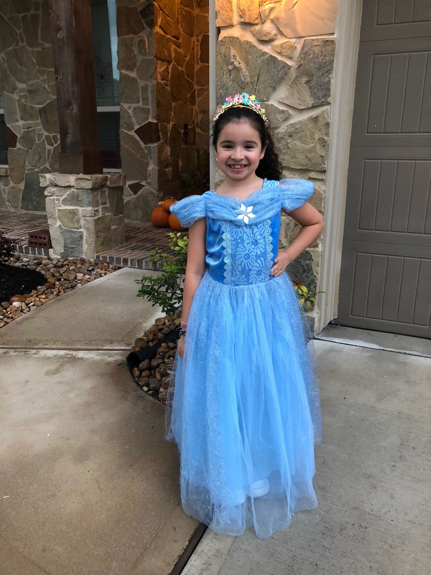 "<div class=""meta image-caption""><div class=""origin-logo origin-image none""><span>none</span></div><span class=""caption-text"">One of Patricia Lopez's daughters donned a Cinderella gown for Halloween.</span></div>"