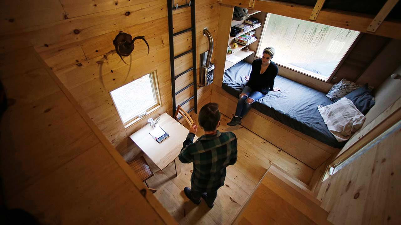Shane Lentz, of Pittsburgh, PA, and his wife Hilary, talk before leaving a tiny house, which they rented for a weekend, in Croydon, N.H.