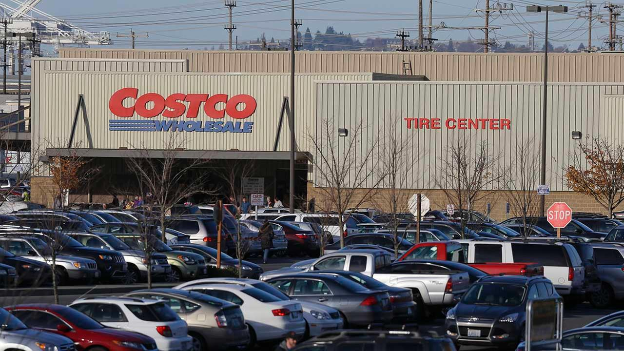 Cars fill the parking lot of a Costco store, Tuesday, Nov. 24, 2015, in Seattle. Health authorities say chicken salad from Costco has been linked to at least one case of E. coli.