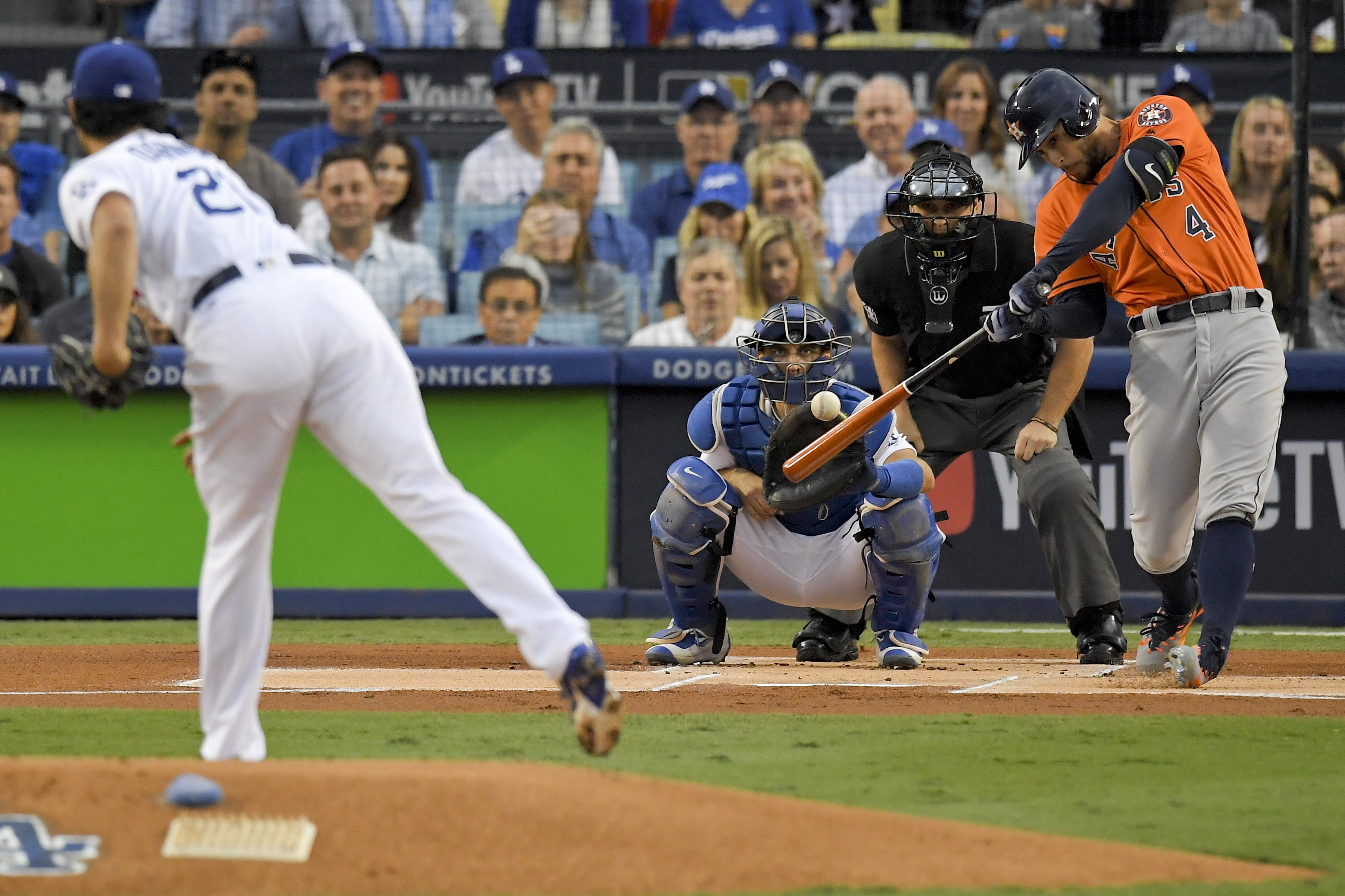 <div class='meta'><div class='origin-logo' data-origin='AP'></div><span class='caption-text' data-credit='AP'>Houston Astros' George Springer, right, hits a double off Los Angeles Dodgers starting pitcher Yu Darvish, of Japan, during the first inning of Game 7. (AP Photo/Mark J. Terrill)</span></div>
