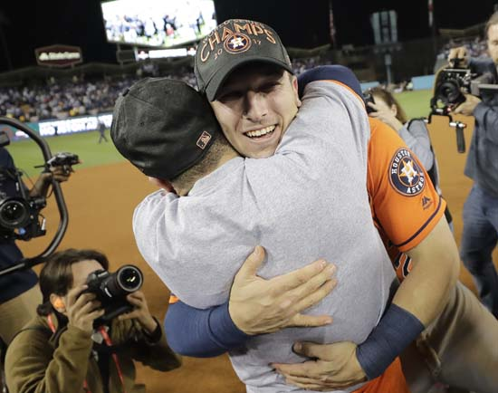 <div class='meta'><div class='origin-logo' data-origin='AP'></div><span class='caption-text' data-credit='AP'>Houston Astros' Jose Altuve and Alex Bregman celebrate after Game 7. (AP Photo/David J. Phillip)</span></div>