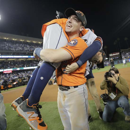 <div class='meta'><div class='origin-logo' data-origin='AP'></div><span class='caption-text' data-credit='AP'>Houston Astros' Jose Altuve and Alex Bregman celebrate after Game 7 of baseball's World Series against the Los Angeles Dodgers. (AP Photo/David J. Phillip)</span></div>