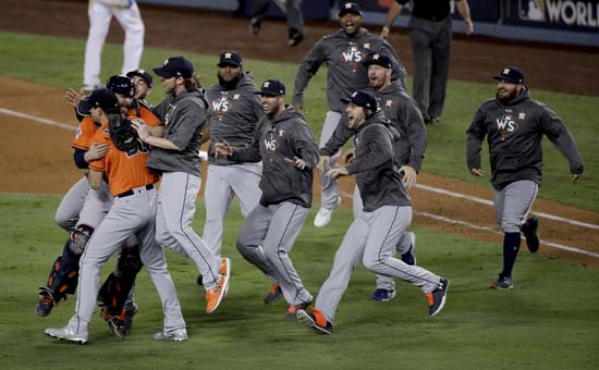 <div class='meta'><div class='origin-logo' data-origin='AP'></div><span class='caption-text' data-credit='AP'>Members the the Houston Astros celebrate their win against the Los Angeles Dodgers in Game 7 of baseball's World Series. (AP Photo/Jae C. Hong)</span></div>