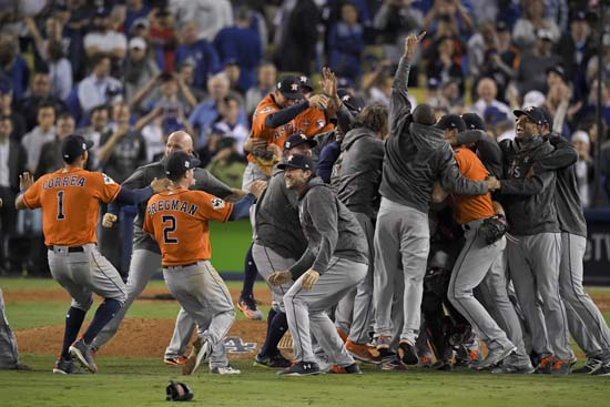 <div class='meta'><div class='origin-logo' data-origin='AP'></div><span class='caption-text' data-credit='AP'>The Houston Astros celebrate after their win against the Los Angeles Dodgers in Game 7 of baseball's World Series. (AP Photo/Mark J. Terrill)</span></div>