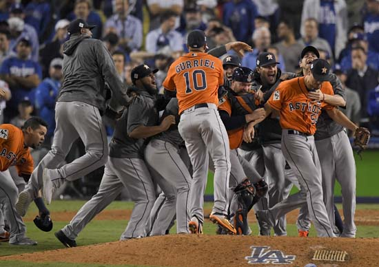 <div class='meta'><div class='origin-logo' data-origin='AP'></div><span class='caption-text' data-credit='AP'>The Houston Astros celebrate after their win against the Los Angeles Dodgers in Game 7. (AP Photo/Mark J. Terrill)</span></div>