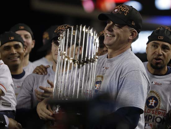 <div class='meta'><div class='origin-logo' data-origin='AP'></div><span class='caption-text' data-credit='AP'>Houston Astros manager A.J. Hinch holds the championship trophy after Game 7 of baseball's World Series. (AP Photo/Matt Slocum)</span></div>