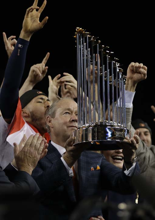 <div class='meta'><div class='origin-logo' data-origin='AP'></div><span class='caption-text' data-credit='AP'>Houston Astros owner Jim Crane holds the championship trophy after Game 7 of baseball's World Series against the Los Angeles Dodgers. (AP Photo/Matt Slocum)</span></div>