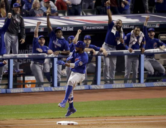 <div class='meta'><div class='origin-logo' data-origin='AP'></div><span class='caption-text' data-credit='AP'>Chicago Cubs' Dexter Fowler celebrates after a home run against the Cleveland Indians during the first inning of Game 7. (AP Photo/Charlie Riedel)</span></div>