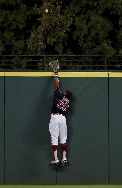 <div class='meta'><div class='origin-logo' data-origin='AP'></div><span class='caption-text' data-credit='AP'>Cleveland Indians left fielder Rajai Davis can't get a glove on a home run by Chicago Cubs' Dexter Fowler during the first inning. (AP Photo/Matt Slocum)</span></div>