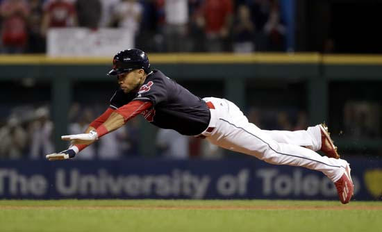 <div class='meta'><div class='origin-logo' data-origin='AP'></div><span class='caption-text' data-credit='AP'>Cleveland Indians' Coco Crisp dives into second after a double against the Chicago Cubs during the third inning of Game 7. (AP Photo/Matt Slocum)</span></div>