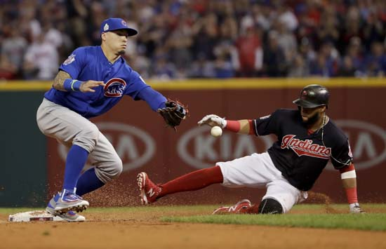 <div class='meta'><div class='origin-logo' data-origin='AP'></div><span class='caption-text' data-credit='AP'>Chicago Cubs' Javier Baez can't handle the ball as Cleveland Indians' Carlos Santana slides safely into second during the third inning of Game 7. (AP Photo/Matt Slocum)</span></div>