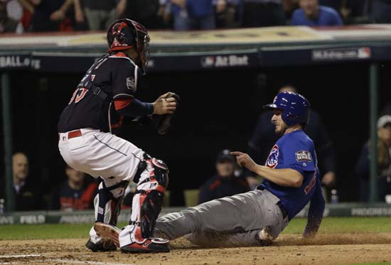 <div class='meta'><div class='origin-logo' data-origin='AP'></div><span class='caption-text' data-credit='AP'>Chicago Cubs' Kris Bryant is safe at home as Cleveland Indians catcher Roberto Perez puts on a late tag during the fourth inning of Game 7. (AP Photo/David J. Phillip)</span></div>
